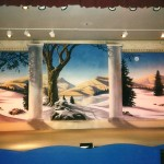 Christmas stage scenery set painted by muralist Paul Barker of Googleplex