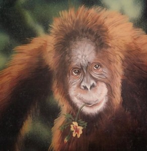 Orangutan with flower in mouth painted by muralist Paul Barker