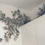 Mural of plants above residential kitchen cupboards by Paul Barker