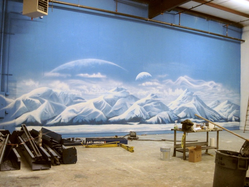 Snowy mountain mural for car dealership in Atlanta by Paul Barker of Googleplex